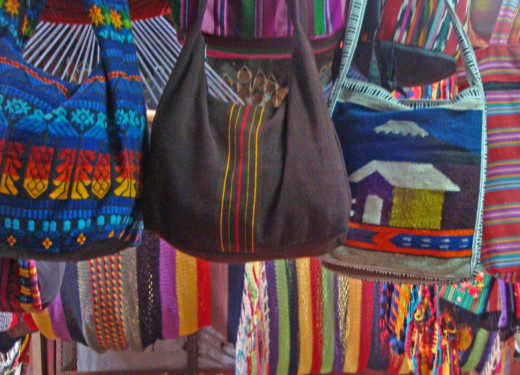 You can find all types of bags and purses for sale, including cloth, leather and woven styles.  Most of the cloth and woven styles are very colorful.