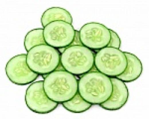 Add sliced cucumbers around the salad