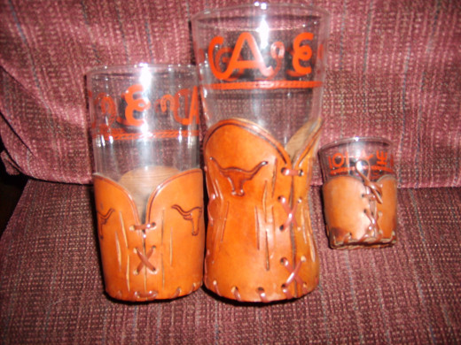 Western glasses -- the lettering and lasso should be brown, not reddish