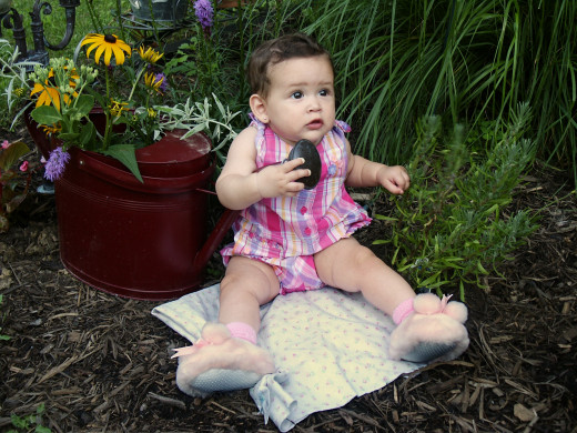 GARDEN BABY by Papabear  Baby on blanket by watering can with flowers