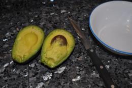 An avocado cut in half.