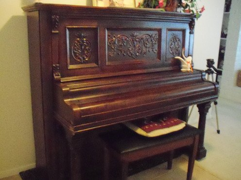 A cherished antique, this is a picture of my mother's piano that I inherited. Keepsakes and mementos, big and small, become part of our lives, and part of our life stories.