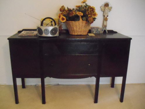 This is my grandmother's buffet. An antique, my mother loved it, and now it has tons of memories (and stories). I inherited it, and now its stories are mine to treasure.