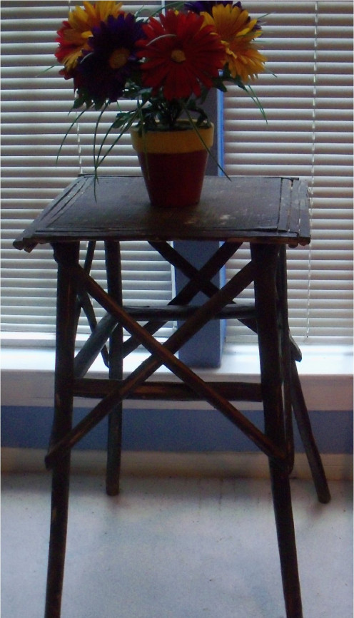 Another antique that once belonged to my grandmother, this table sits in my bedroom. Handmade, there is a story connected to it that tells why and how it was created.