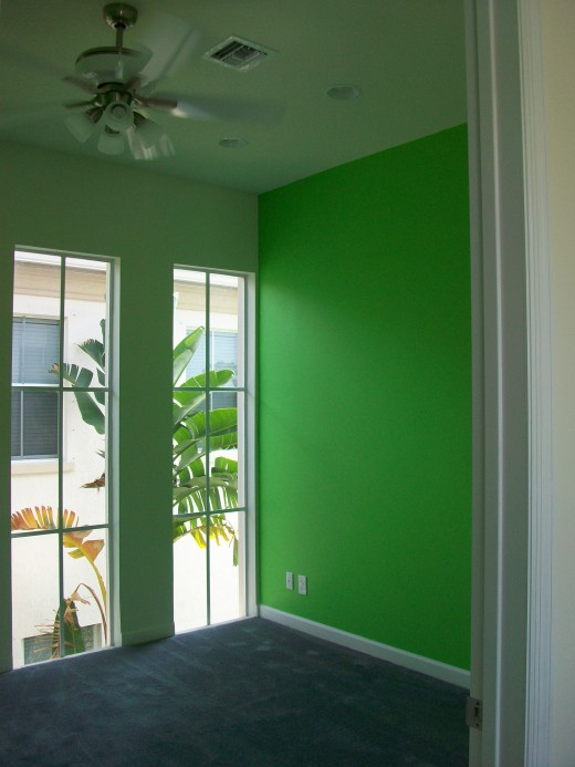 This homeowner used a bright, happy green for the walls of her children's playroom.