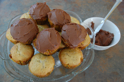 frosted and unfrosted peanut butter banana muffins