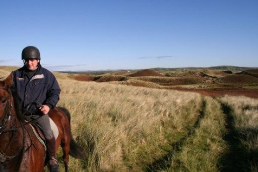 Rider in tall beach grass, County Donegal