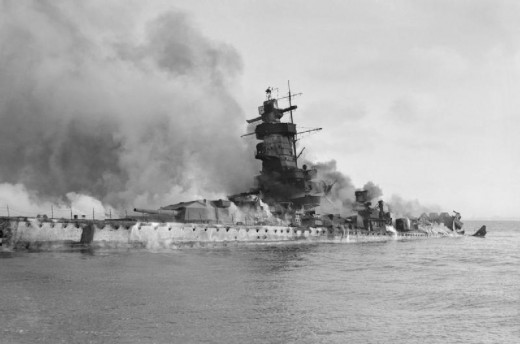 The KMS Admiral Graf Spee has been scuttled and sinks in flames