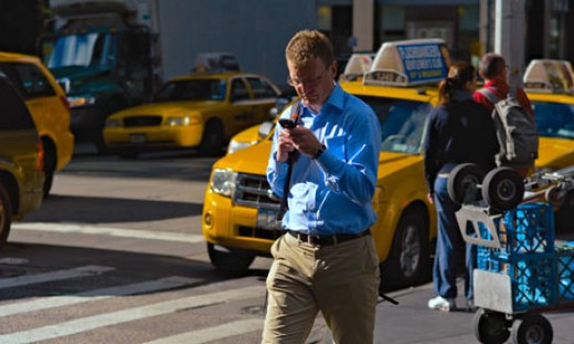 Walking and texting while crossing a street in heavy city traffic.  What could go wrong?