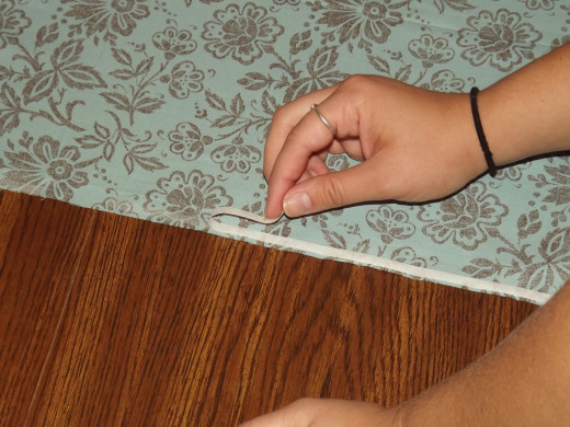 Peeling the paper off the fusible strip.
