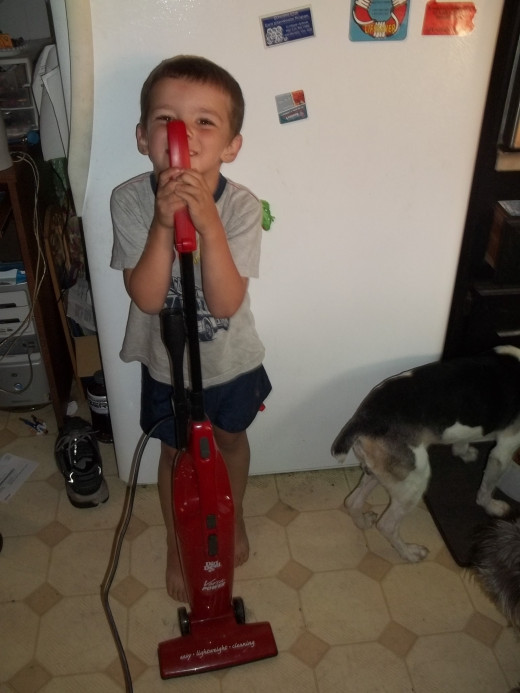 My toddler and his trusty vacuum!