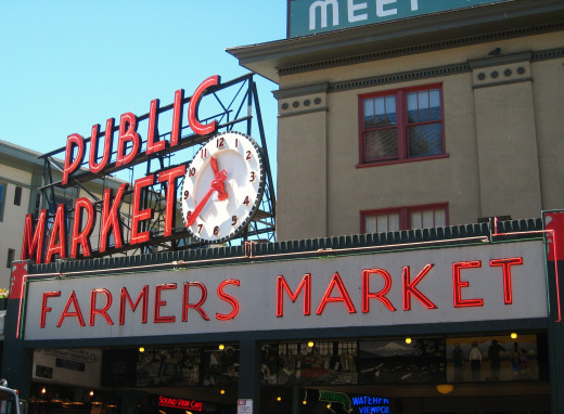 Pike Place Market clock and sign.