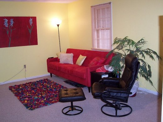 A red sofa and red artwork enliven a room