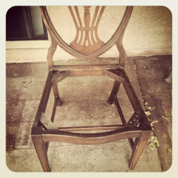 Sanding my chair on the back patio