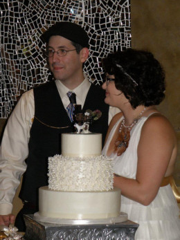 Cutting our wedding cake as Mr. and Mrs. Rode