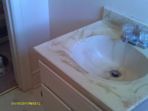 Outdated sink with small storage underneath