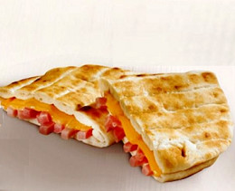 flatbread filled with ham, cheese and fresh hebs