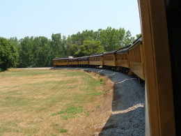 As the train rounds the curve, passengers can see the entire length of the train.