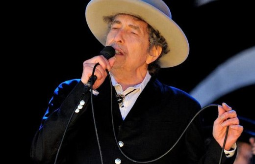 Bob Dylan sings one of his many hits at  the Hop Farm festival