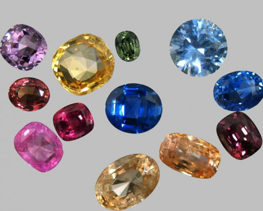 Sapphire is a variety of corundum that occurs in multiple shades of blue, and in many other hues - mauve, yellow, orange, pink-orange (Padparadscha), green,  black... - except red (red corundum is ruby).