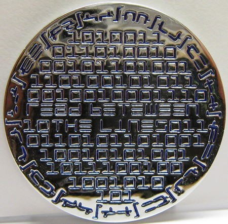 Back of digital hell geocoin