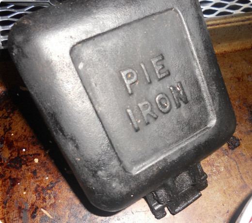 Close the pie iron, latch it and you're ready to cook over the fire...