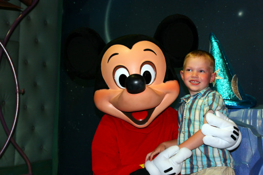Meeting Mickey Mouse is a fun experience for some children at Disneyland - other children might be frightened of the characters.