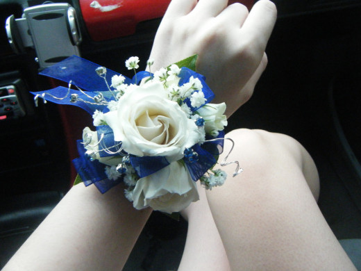 A corsage tied to the wrist