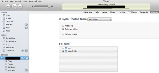 """Check the """"Sync Photos From"""" box, then select which folders you want to sync. Click """"Sync"""" when you're done."""