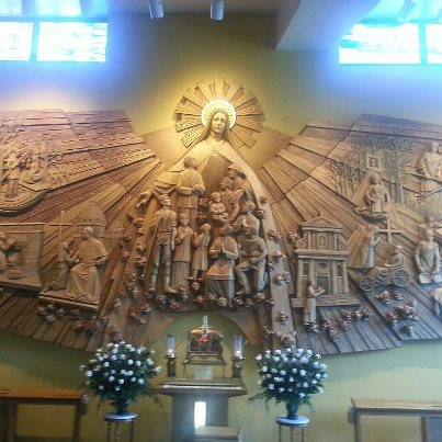 The wood carving that depicts her life story inside the National Shrine of St. Therese, Illinois