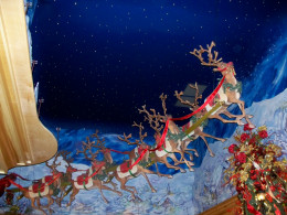 Santa and his reindeer flying high above the Incredible Christmas place