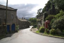 Looking back through the village with its square stone barns and farmhouses