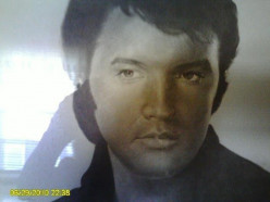 Ruby bought this picture of Elvis the day he died and cried all day.