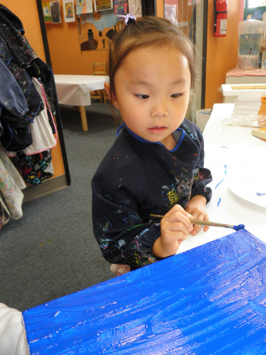 A student learning art at Green Forest Art Studio in Union City, Ca. Students learn art, drawing, painting and also work with clay.