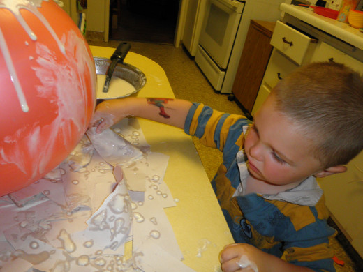My art skills come in handy when writing also. I took photos of my grandson and I making an art globe for a hub I wrote. This was a fun project for him and I.