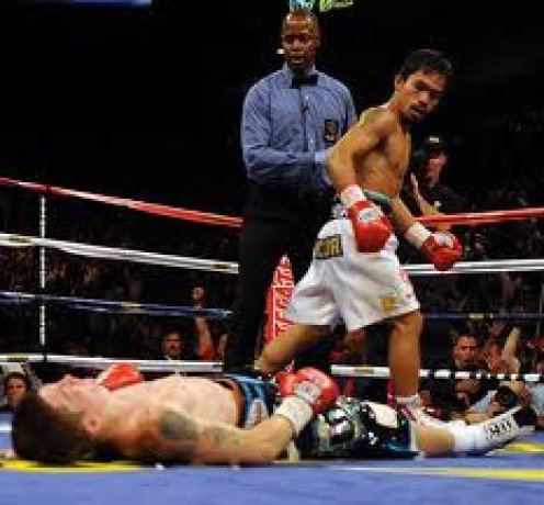 Manny Pacquiao vs Ricky Hatton was a short, brutal fight. Pacman knocked Hatton down twice in round one and finished him off in the second stanza with a devastating left hand.