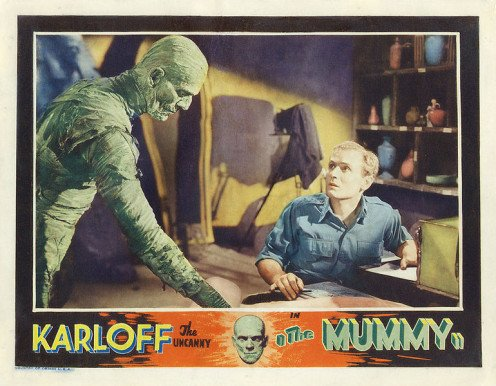 "A movie poster for the classic 1932 monster movie ""The Mummy."""
