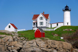 The Nubble Light in York, ME is located on a small island just a few yards offshore. This lighthouse is noted for its Christmas decorations that it receives every year.