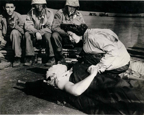 Flight nurse Jane Kendeigh caring for wounded soldier on Iwo Jima (1945)