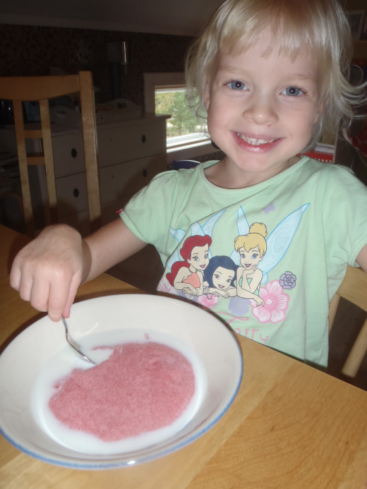 My daughter is having pat porridge with some milk and sugar.