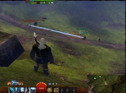 Two small groups of players in a WvWvW match fight for control near a strategic point.