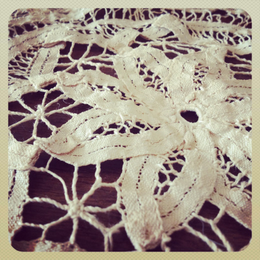 Turn shabby into shabby chic with vintage doilies.  This one has a lovely floral vibe.