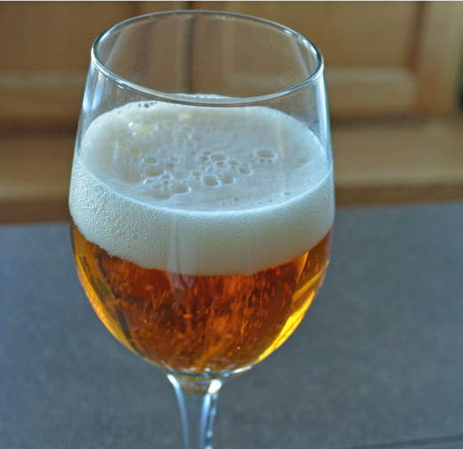 Beer in a wineglass illustrates that just like wines, different beers go with different foods.