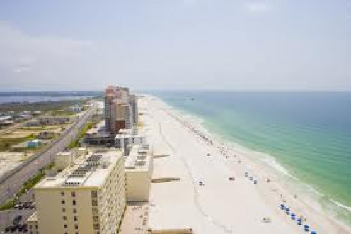 Gulf Shores, Alabama has sandy white beaches and lots of clubs around for a fun night life as well.
