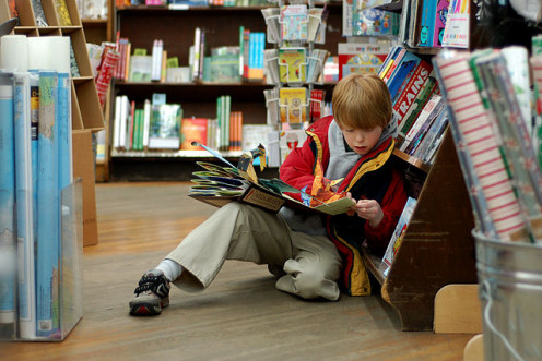 A child reading in Brookline Booksmith, an independent bookstore in Boston, Massachusetts.