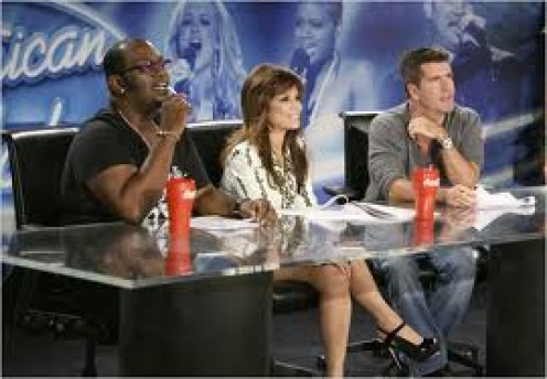 American Idol features three judges and they judge amateur singing acts.