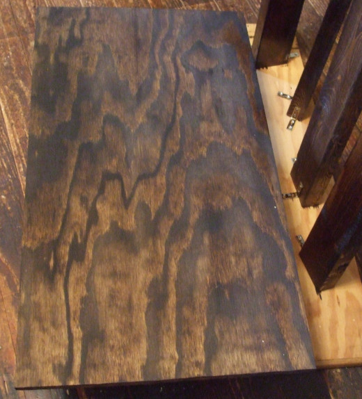 Staining in the middle of the table building process works very well.