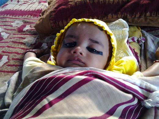 A baby toward his Sweet sleep After having breastfeeding.