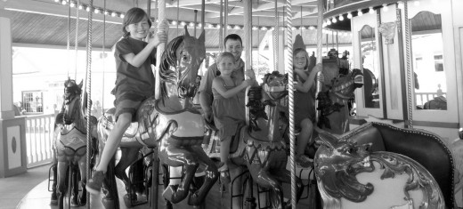 Enjoying the old fashioned carousel in the park.