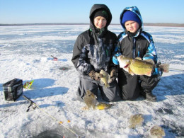Fishing for bass under the ice with rod and reel.